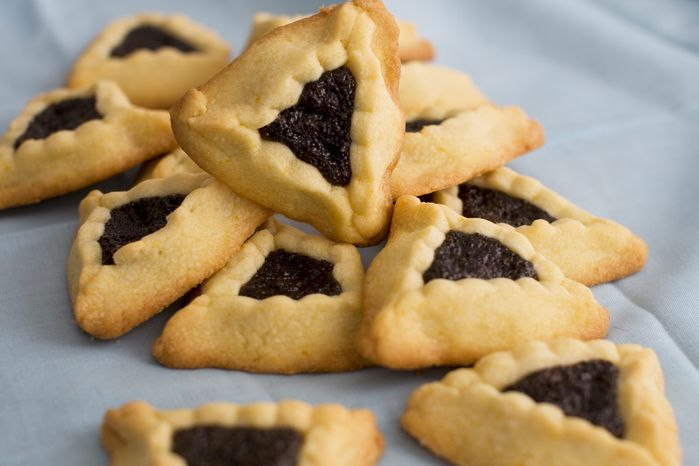 ** FILE ** Triangular-shaped orange-poppy seed hamantashen cookies are a dessert favorite on the holiday of Purim. (Associated Press)