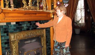Erin Sigl, one of the owners of Copper King Mansion, stands next to a fireplace inside the historic home in Butte, Mont. The 34-room mansion that W.A. Clark built in Butte more than a century ago is now a bed-and-breakfast and offers visitors a glimpse into the pampered lives of the robber barons who ruled American business at the turn of the previous century. (Associated Press)