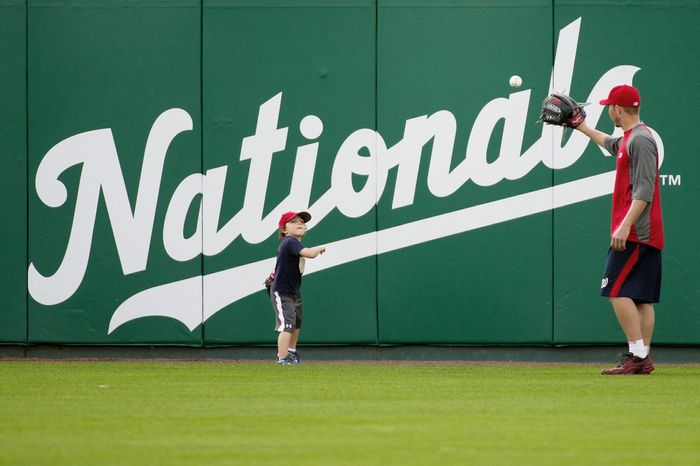 andrew harnik/the washington times Nationals relief pitcher Sean Burnett plays catch with his son Sebastian, 3, on Thursday at Space Coast Stadium in Viera, Fla.