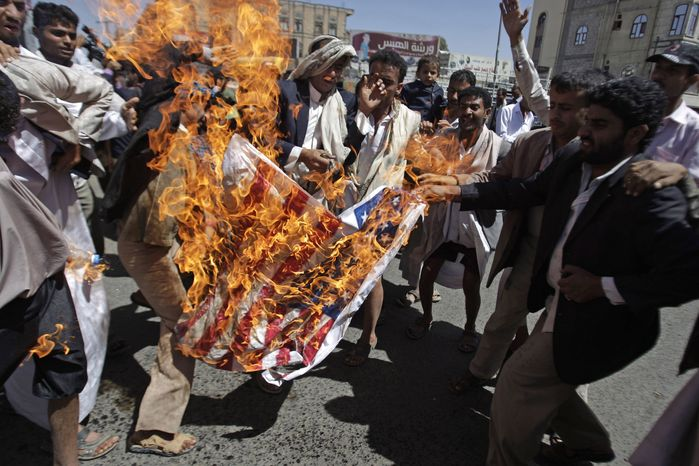 Yemenis burn the U.S. flag on March 1, 2012, to condemn the reported burning of holy Korans in Afghanistan by U.S. troops during a demonstration in Sanaa, Yemen. (Associated Press)