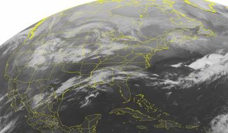 This NOAA satellite image taken March 2, 2012, at 12:45 a.m. EST shows variable cloud cover over the Midwest as a storm system organizes over the Central and Southern Plains and a cold front drops into the Upper Midwest. (Associated Press/Weather Underground)