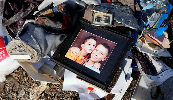 A picture frame and personal belongings are remains left behind in Harrisburg, Ill. on Thursday, March 1, 2012.  A pre-dawn twister flattened entire blocks of homes  Wednesday as violent storms ravaged the Midwest and South.  (AP Photo/Robert Ray)