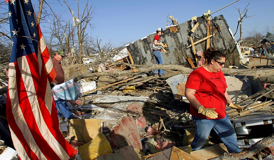 Family members and friends try to salvage what they can after a tornado destroyed their neighborhood homes Wednesday, Feb. 29, 2012, in Harrisburg, Ill. The tornado that blasted Harrisburg, killing six, was an EF4, the second-highest rating given to twisters based on damage. Scientists said it was 200 yards wide with winds up to 170 mph. (AP Photo/Seth Perlman)