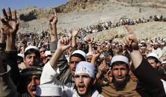 ** FILE **  In this Feb. 24, 2012, file photo, Afghans shout anti-American slogans during an anti-U.S. protest in Ghani Khail, east of Kabul, Afghanistan over the burning of Korans at a U.S. military base. (AP Photo/Rahmat Gul, File)