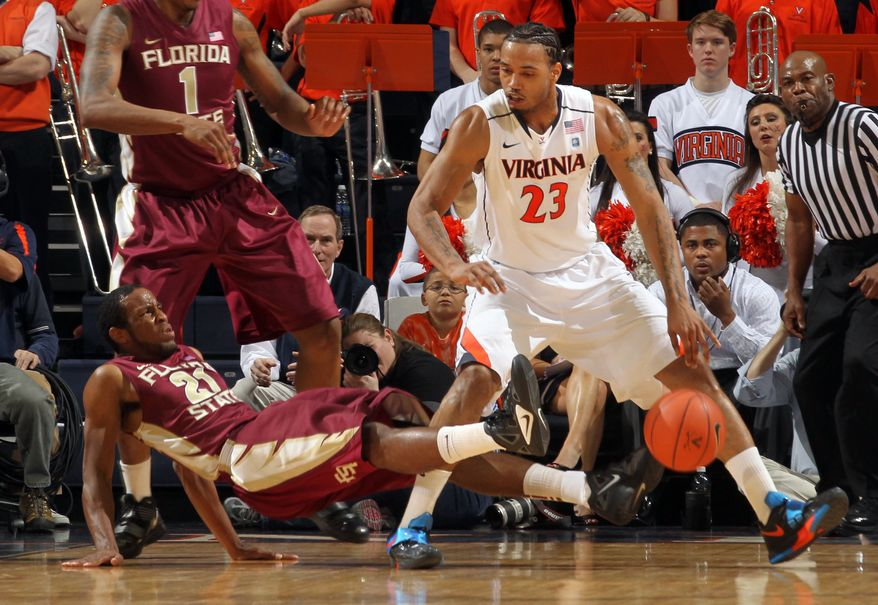Florida State guard Michael Snaer draws an offensive foul from Virginia forward Mike Scott during the first half Thursday, March 1, 2012, in Charlottesville, Va. (AP Photo/Andrew Shurtleff)