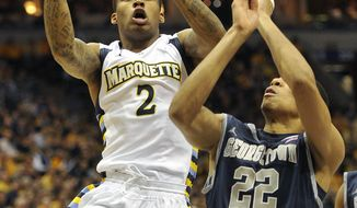 Marquette's Vander Blue drives to the basket against Georgetown's Otto Porter during the first half Saturday, March 3, 2012, in Milwaukee. Blue had 13 points in Marquette's 73-59 win. (AP Photo/Jim Prisching)