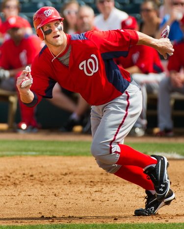 Washington Nationals right fielder Bryce Harper (34) runs to second base in the second inning as the Washington Nationals play the Houston Astros during spring training at the Osceola County Stadium, Kissimmee, Fla., Saturday, March 3, 2012. (Andrew Harnik/The Washington Times)