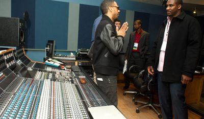 Musician Ryan Leslie (left) meets last month with former NFL football player Darren Howard at the first-ever NFL Business of Music Boot Camp at New York University's Clive Davis Institute of Recorded Music. This week, the league offered an assist to current and former players like Mr. Howard who are trying to find their footing in a business that can be just as brutal and unforgiving as football. (Associated Press)