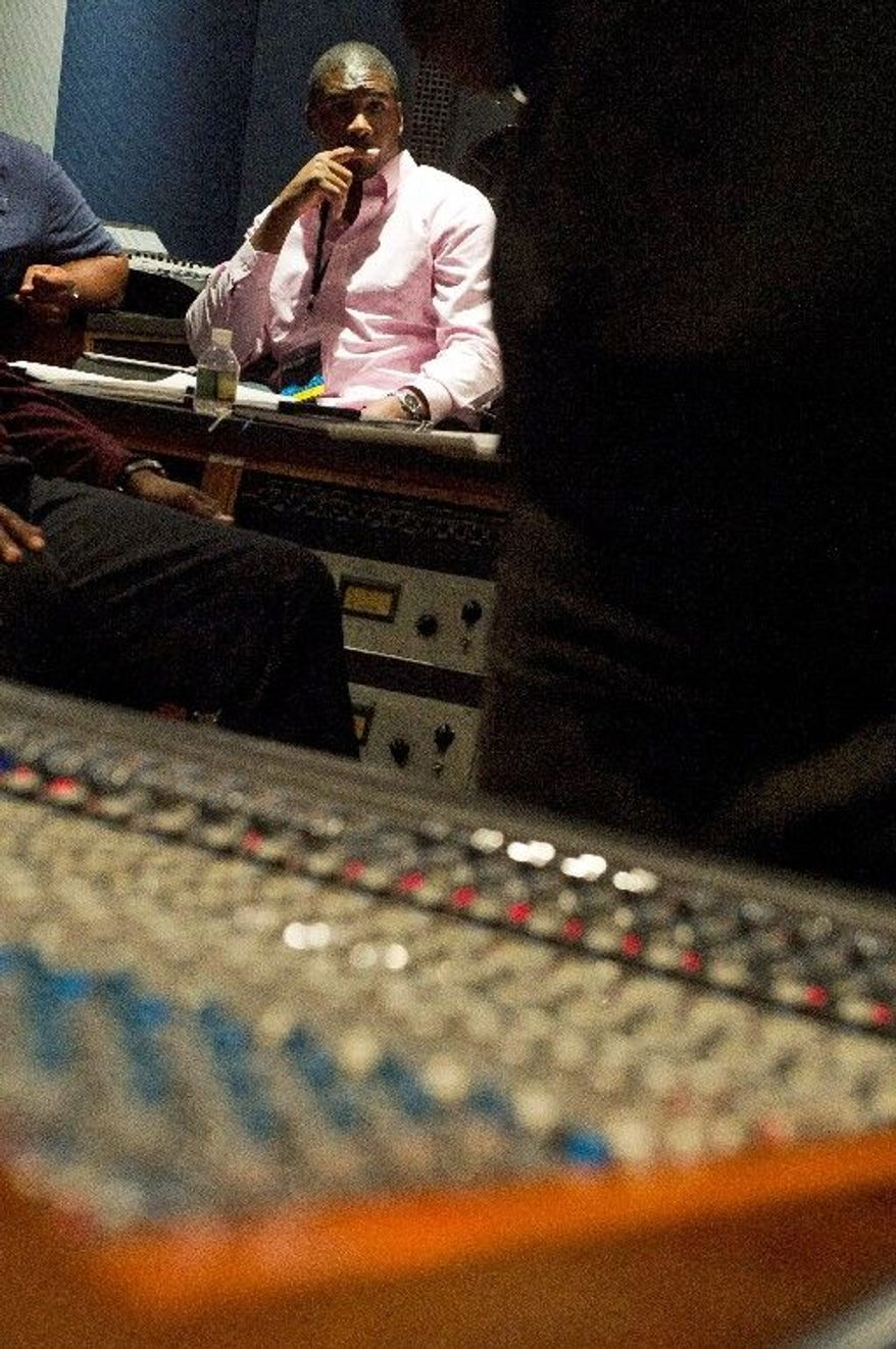 Former NFL football player Darren Howard takes part last month in the first-ever NFL Business of Music Boot Camp at New York University's Clive Davis Institute of Recorded Music. Each player was paired with a mentor to coach him. (Associated Press)