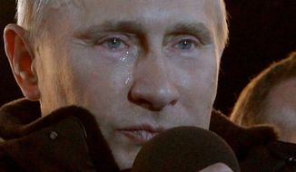 "Prime Minister Vladimir Putin, who claimed victory in Russia's presidential election, has tears in his eyes as he watches the massive rally of his supporters at Manezh Square. ""I promised you we would win. We won,"" he said. ""Glory to Russia."" (Associated Press)"