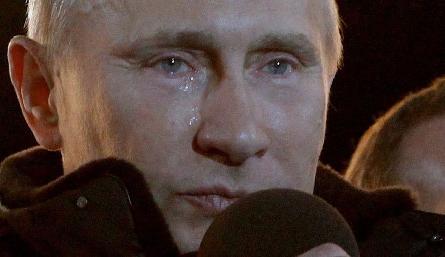 """Prime Minister Vladimir Putin, who claimed victory in Russia's presidential election, has tears in his eyes as he watches the massive rally of his supporters at Manezh Square. """"I promised you we would win. We won,"""" he said. """"Glory to Russia."""" (Associated Press)"""