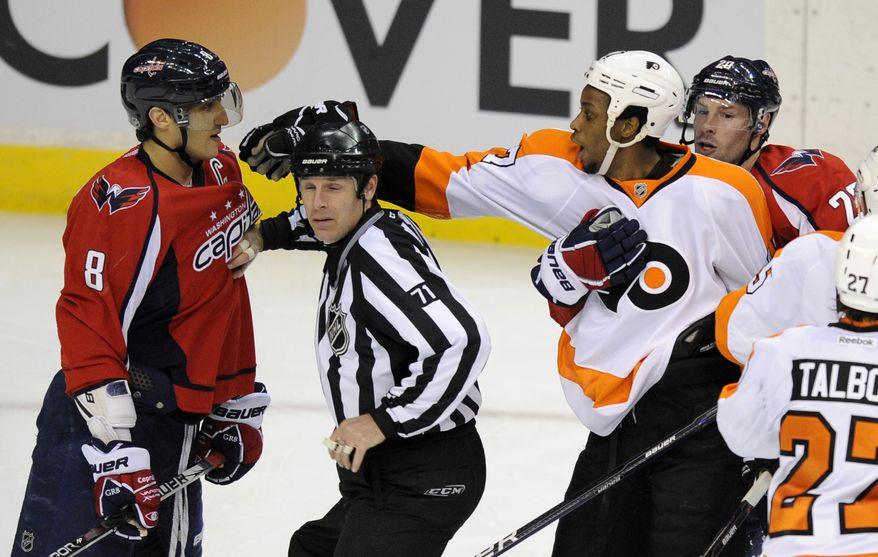 Washington Capitals left wing Troy Brouwer, far right, holds back Philadelphia Flyers right wing Wayne Simmonds, second from right, as he reaches for Capitals' Alex Ovechkin (8) during the third period of an NHL game, Sunday, March 4, 2012, in Washington. The Flyers won 1-0. (AP Photo/Nick Wass)