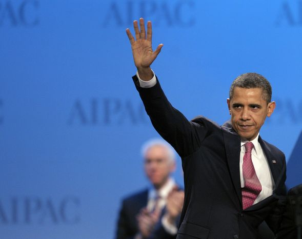 President Obama waves to the audience after addressing the American Israel Public Affairs Committee (AIPAC) Policy Conference in Washington on Sunday, March 4, 2012. (AP Photo/Cliff Owen)