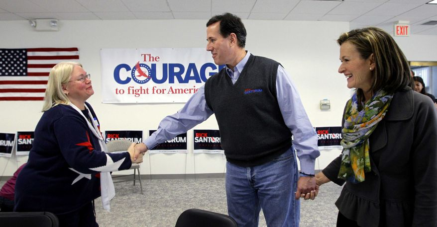 ** FILE ** Republican presidential candidate, former Pennsylvania Sen. Rick Santorum, and his wife, Karen, right, visit volunteers during a stop at his campaign field office, Tuesday, Feb. 28, 2012, in Grand Rapids, Mich. (AP Photo/Eric Gay)
