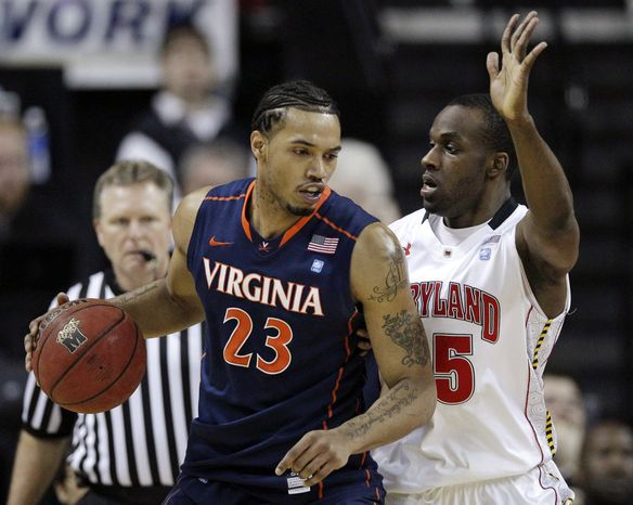 Virginia forward Mike Scott, left, drives against Maryland's James Padgett in the first half of an NCAA basketball game in College Park, Md., Sunday, March 4, 2012. (AP Photo/Patrick Semansky)