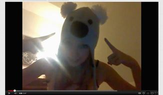 """Commenters on YouTube curse and declare young video creators """"attention whores."""" This image shows a girl with a koala hat asking """"Am I pretty or ugly?"""" The video has received more than 4 million views and in excess of 107,000 anonymous, often hateful responses."""