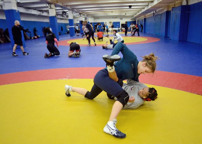 Helen Maroulis, a wrestler from Rockville, Md, may be the best U.S. wrestler in her weight class. She is currently training at the U.S. Olympic Training Center in Colorado Springs, Colo. She and other members of the U.S. team, as well as wrestlers from other countries, spent time training together, Thursday,Mar. 1, 2012. Maroulis and Venezuelan wrestler Marcia Andrades practice a two-arms one leg professional wrestling move. (Bryan Oller/Special to the Washington Times)