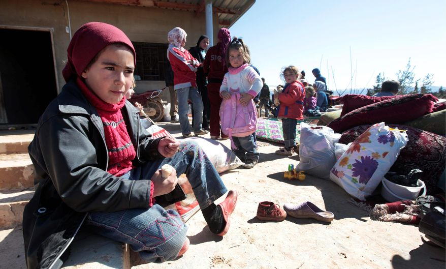 The United Nations is sending two envoys to Syria to press the case to allow humanitarian relief workers unhindered access. These Syrian children fled with their families from Qusair, near Homs, to the Lebanese-Syrian border village of Qaa. (Associated Press)