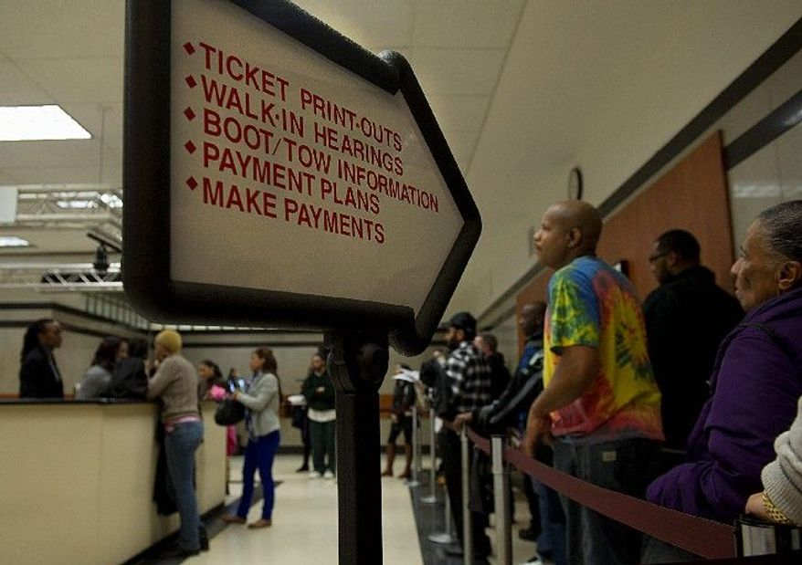 In fiscal year 2011, the District raked in $92.6 million for 1.6 million issued parking tickets. The city is on pace to surpass those numbers this year, according to a report issued Monday by AAA Mid-Atlantic. (Barbara L. Salisbury/The Washington Times)