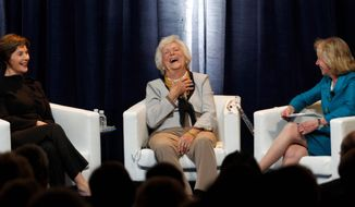 """Former first ladies Laura Bush and Barbara Bush share a light moment with moderator Doris Kearns Goodwin (right) during a discussion Monday that was part of the conference """"America's First Ladies: An Enduring Vision"""" at SMU in Dallas. (Associated Press)"""
