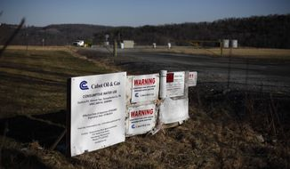 A Cabot Oil & Gas wellhead in Dimock, Pa., is seen Feb. 13, 2012. (Associated Press)-FILE