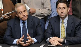 **FILE** New York Mets owner Fred Wilpon (left) and COO Jeff Wilpon listen to a question from the media during a Oct. 29, 2010, baseball news conference in New York. (Associated Press)