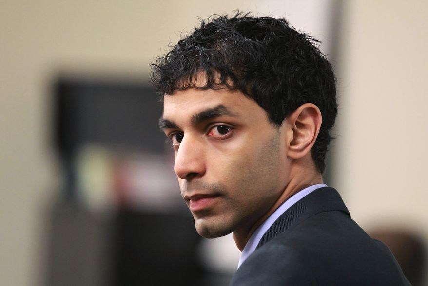 Former Rutgers University student Dharun Ravi awaits the start of his trial at the Middlesex County Courthouse in New Brunswick, N.J., on Friday, March 2, 2012. (AP Photo/The Star-Ledger, John Munson, Pool)