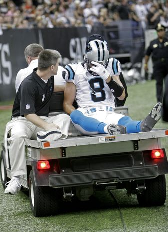 **FILE** Trainers cart Carolina Panthers quarterback David Carr off the field after he sustained a first-quarter injury during the Panthers' 16-13 road victory against the New Orleans Saints on Oct. 7, 2007. (Associated Press)