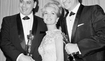 "Robert B. Sherman (left) and his brother Richard M. Sherman, winners of the 1965 Oscars for best score and best song for their work on ""Mary Poppins,"" pose with actress Debbie Reynolds. Robert Sherman died has died at age 86. (Associated Press)"