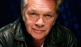 ** FILE ** In this Oct. 21, 2010, file photo, recording artist John Mellencamp poses for a portrait in New York. (AP Photo/Jeff Christensen, file)