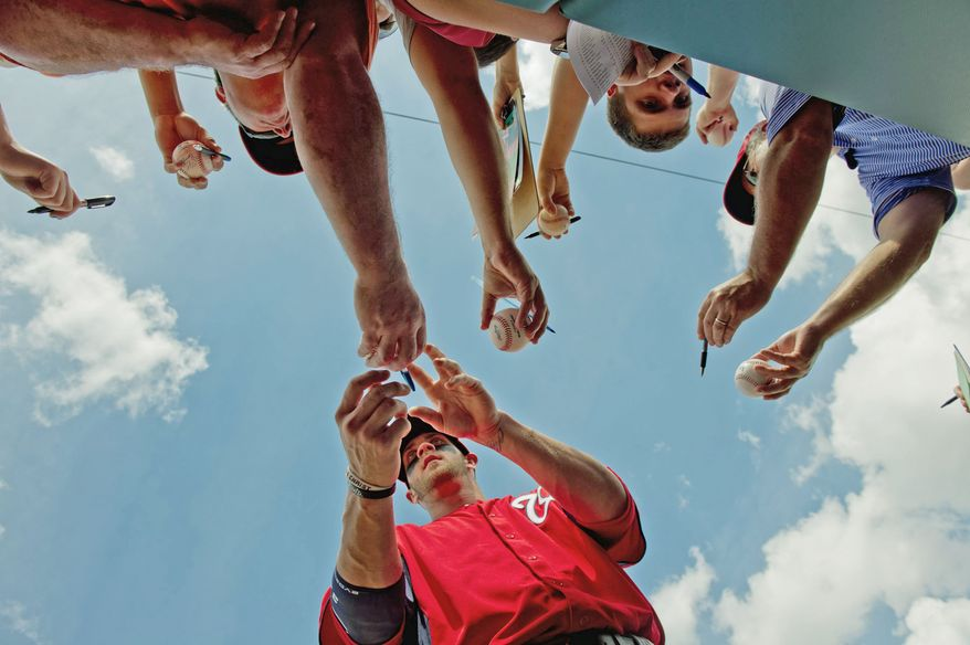 Nationals outfielder Bryce Harper aims to please, whether it's obliging autograph-seeking fans or making the necessary adjustments to refine his game. (Andrew Harnik/The Washington Times)