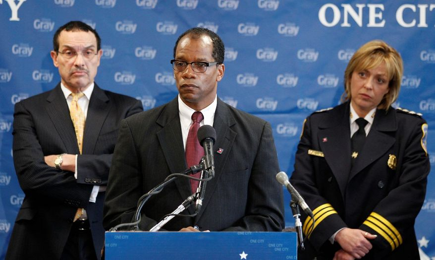 Vincent C. Gray (left), then D.C. mayor-elect, listens on Dec. 16, 2010, as his nominee for fire chief, Kenneth B. Ellerbe, fields a question at a news conference. Some say the city should have conducted a national search to fill the post. (Associated Press)