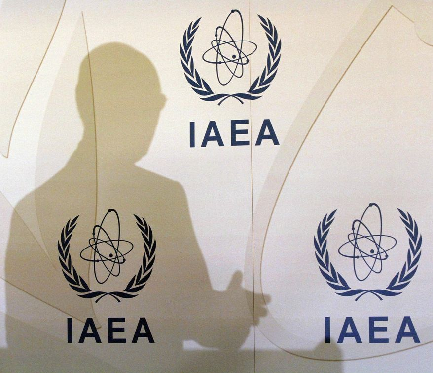 Director General of the International Atomic Energy Agency, IAEA, Yukiya Amano of Japan casts a shadow on the wall during a news conference after a meeting of the IAEA's board of governors at the International Center, in Vienna, Austria, Monday, March 5, 2012. (AP Photo/Ronald Zak)