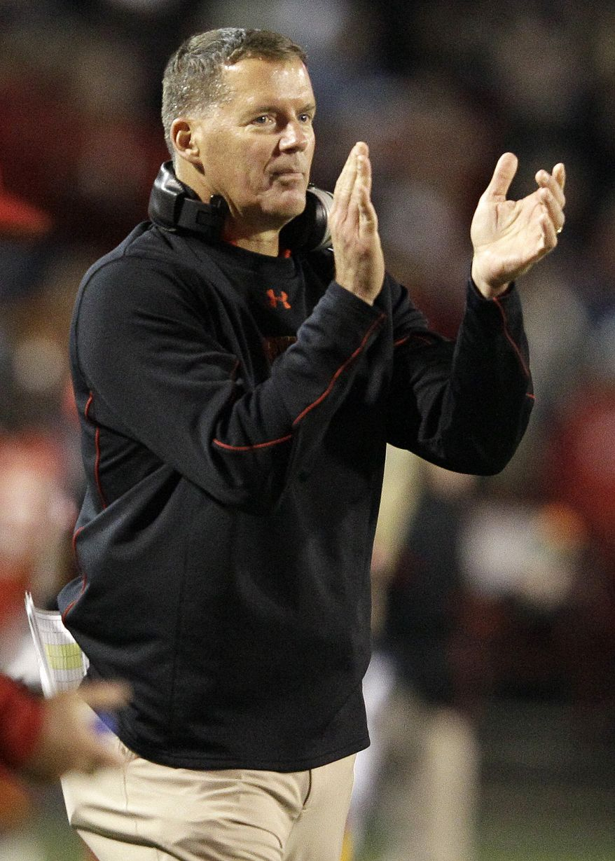 FILE - In this Oct. 15, 2011 file photo, Maryland head coach Randy Edsall watches action in the second half of an NCAA college football game against Clemson, in College Park, Md. Undaunted by the loss of his former starting quarterback and the transfer of several other key players, Edsall looks toward spring practice as a new beginning in his effort to build the Terrapins into a winner. (AP Photo/Patrick Semansky, File)