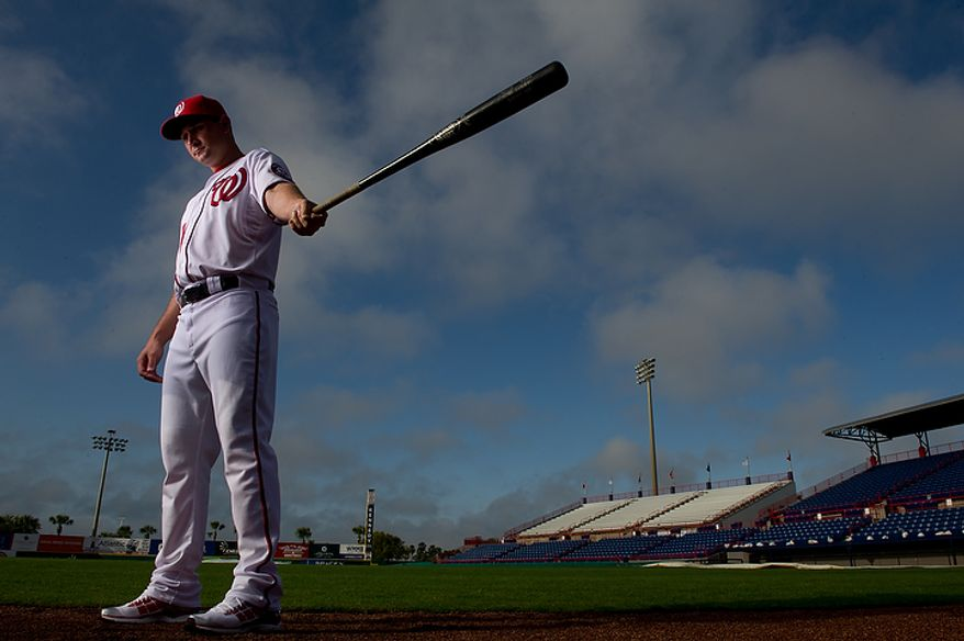 Washington Nationals third baseman Ryan Zimmerman (11) poses for a portrait during photo day at spring training, Viera, Fla., Tuesday, February 28, 2012. (Andrew Harnik/The Washington Times)