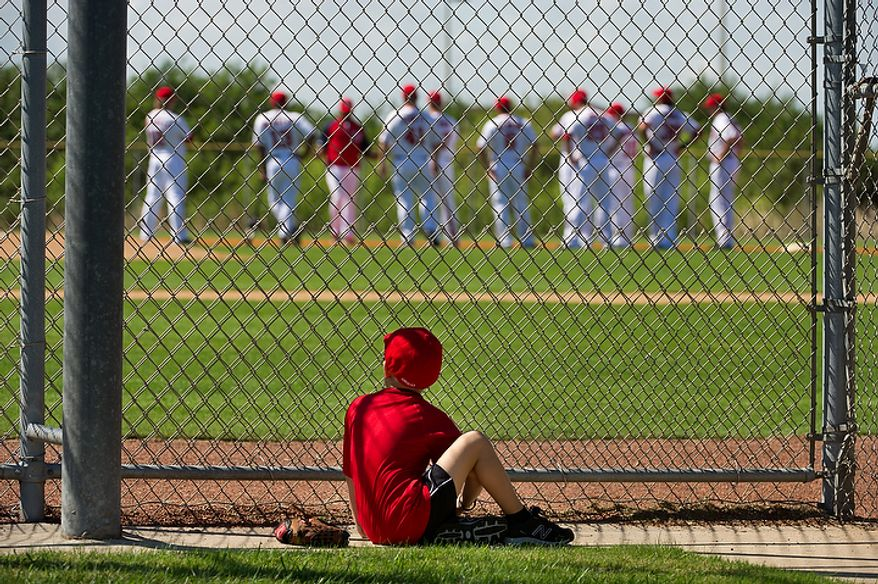 Six-year-old Andy Fronczek of Annandale, Va., watches Washington Nationals players out on the field during spring training, Viera, Fla., Tuesday, February 28, 2012. (Andrew Harnik/The Washington Times)
