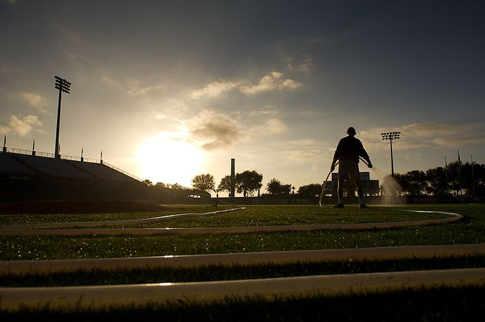 A member of the grounds crew waters the infield in the early morning hours before the Washington Nationals practice during spring training at Space Coast Stadium, Viera, Fla., Wednesday, Feb. 29, 2012. (Andrew Harnik/The Washington Times)
