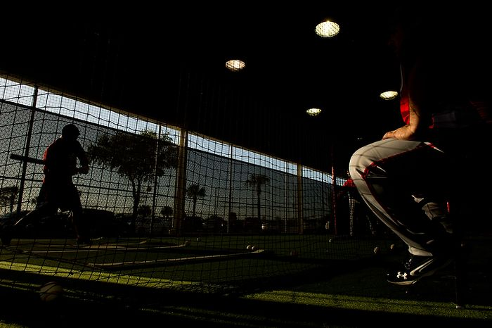 Washington Nationals catcher Jhonatan Solano (23), left, takes batting practice in the early morning hours before the Washington Nationals practice during spring training at Space Coast Stadium, Viera, Fla., Wednesday, Feb. 29, 2012. (Andrew Harnik/The Washington Times)