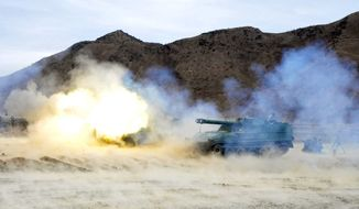 The 2nd Corps of the Korean People's Army in North Korea conducts a live-fire exercise near North Korea's southwest coast on Monday, March 5, 2012. (AP Photo)