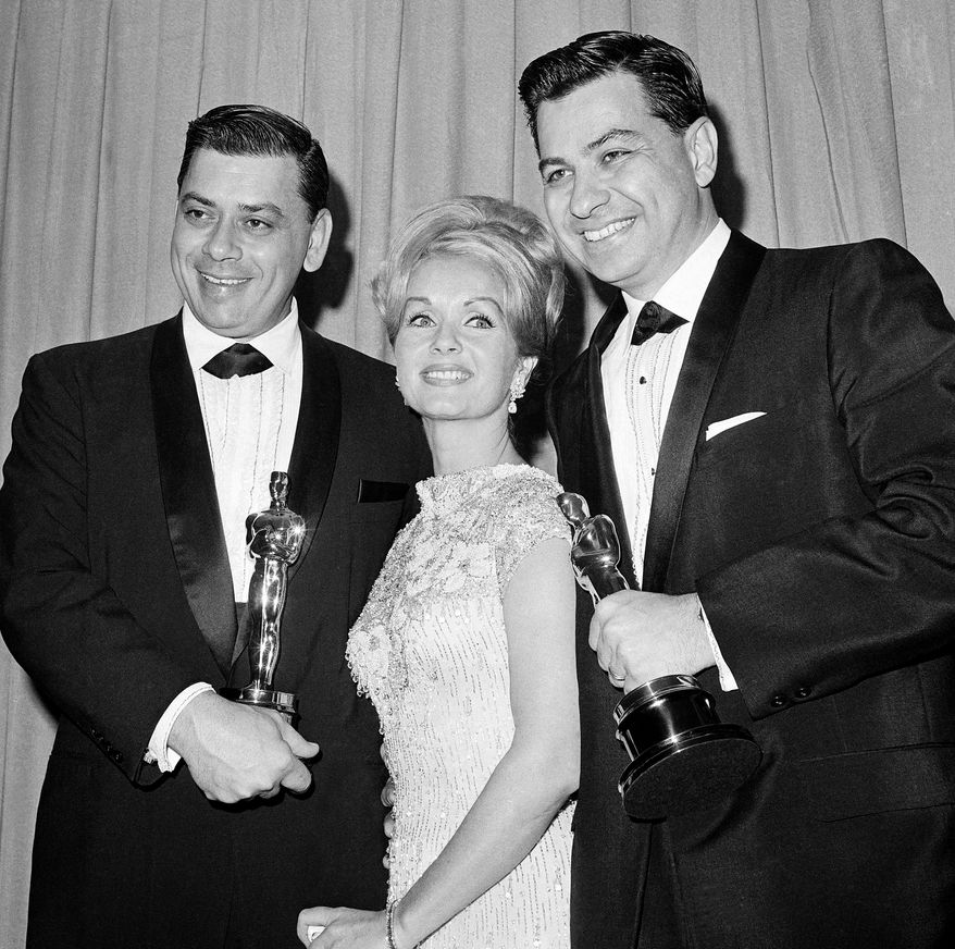"""**FILE** Actress Debbie Reynolds poses April 5,1965, in Santa Monica Calif., with Academy Award winners for best music Richard M. Sherman (right) and Robert Sherman, who received the award for """"Mary Poppins."""" Songwriter Sherman, who wrote the tongue-twisting """"Supercalifragilisticexpialidocious"""" and other enduring songs for Disney classics, died March 5, 2012. He was 86. (Associated Press)"""