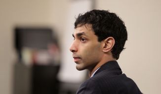 ** FILE ** Dharun Ravi sits in a courtroom during his trial at the Middlesex County Courthouse in New Brunswick, N.J., on Monday, March 5, 2012. (AP Photo/The Star-Ledger, John O'Boyle, Pool)