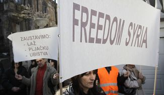 "Protesters hold banners that read ""Freedom Syria"" and ""Stop the: lies, stealing, murder"" during a March 6, 2012, rally against Syrian President Bashar Assad regime in front of the Syrian embassy in Belgrade, Serbia. (Associated Press)"