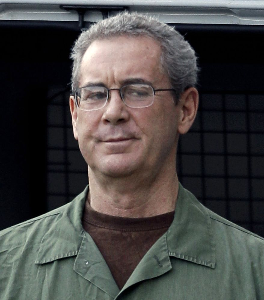 ** FILE ** Jailed Texas tycoon R. Allen Stanford arrives in custody at the federal courthouse in Houston in August 2010. (AP Photo/David J. Phillip)