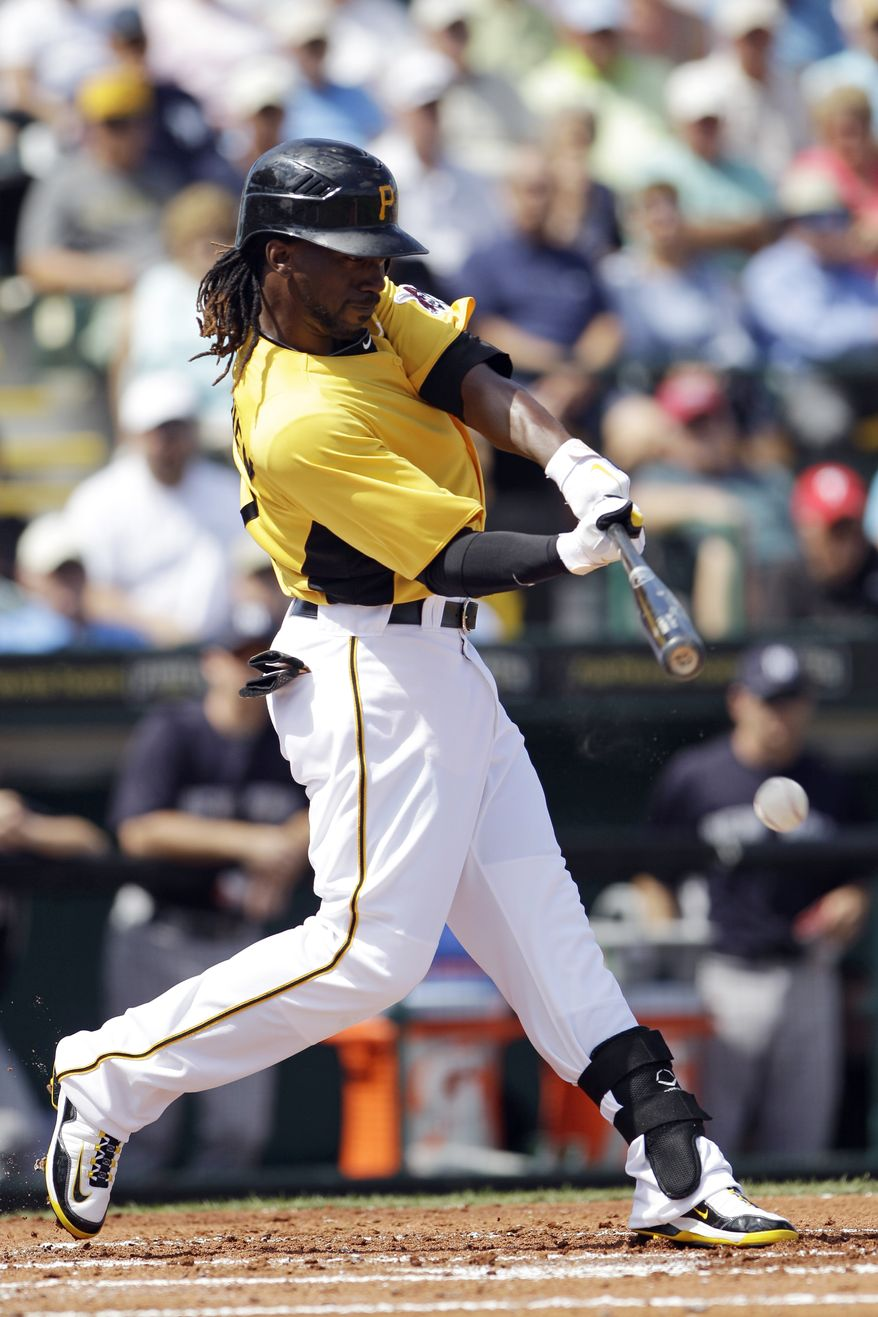 Pittsburgh Pirates' Andrew McCutchen hits an RBI single off New York Yankees pitcher CC Sabathia in the first inning Tuesday, March 6, 2012, in Bradenton, Fla. (AP Photo/Matt Slocum)
