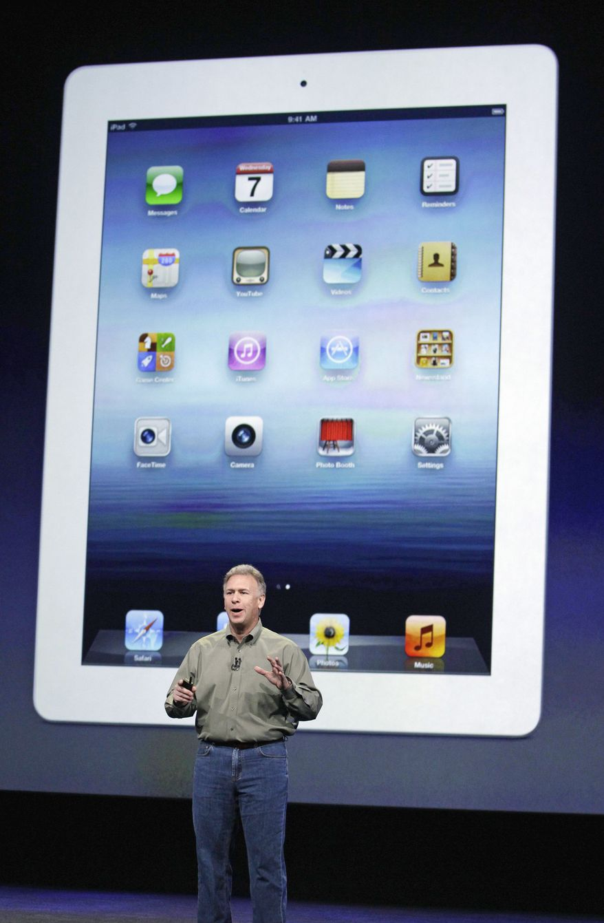 Apple Senior Vice President Phil Schiller talks about the new iPad Wednesday in San Francisco. The device, which goes on sale next week, has new features but no distinguishing name. (Associated Press)