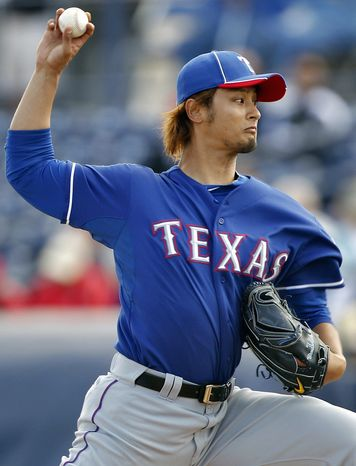 Texas right-hander Yu Darvish threw 36 pitches, 26 for strikes, against a San Diego split squad. (Associated Press)