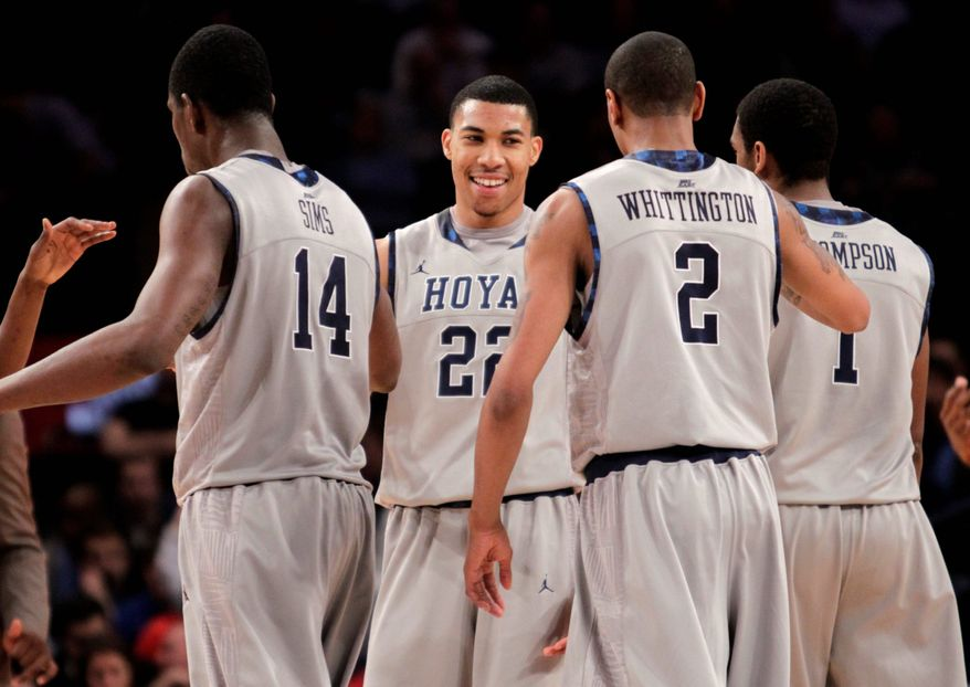 Georgetown's Otto Porter (facing camera) is congratulated by (from left) Henry Sims, Greg Whittington and Hollis Thompson during his 20-point, six-rebound performance. (Associated Press)