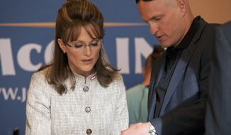 "In this undated image released by HBO, Julianne Moore portrays Sarah Palin, left, and Woody Harrelson portrays campaign strategist Steve Schmidt in a scene from ""Game Change,"" a film about Palin and the 2008 presidential race, premiering Saturday, March 10, at 9 p.m. on HBO. (AP Photo/HBO, Phil Caruso)"