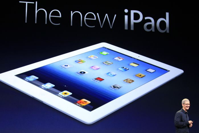 Apple CEO Tim Cook introduces the new iPad during an event in San Francisco on Wednesday, March 7, 2012. The new model features a faster processor and a screen that's even sharper than a high-definition television's. (AP Photo/Jeff Chiu)