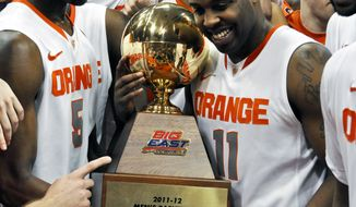 Syracuse's Scoop Jardine (11) and fellow teammates celebrate their regular-season championship after defeating Louisville 58-49 in Syracuse, N.Y., Saturday, March 3, 2012. (AP Photo/Kevin Rivoli)